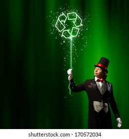Image of man magician against color background. Recycle concept