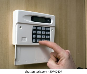 Image of a man setting a burglar alarm