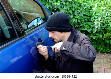 Image of a man stealing a car