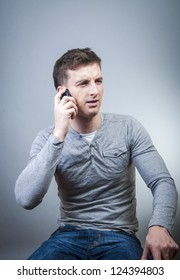 An image of man talking by phone