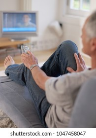 An image of a man watching TV