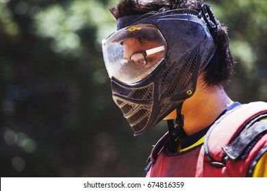 Image of a man wearing paintball protective facial mask covering entire face