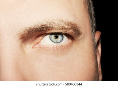 Image of man's blue eye close up