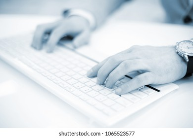Image of man's hands typing. Selective focus.