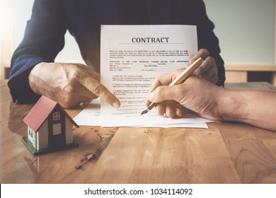 Image of Man's notary public hand pointing at the contract. business man, law attorney, lawyer notary public, bank manager concept.
