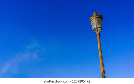 Image of many street lights around quba mosque medina with beautiful cloudless blue sky background. Focus at street light pole.  Others in gradient blur