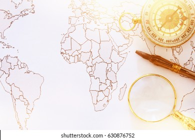 Image of map, magnifying glass and old compass. selective focus. travel destination concept