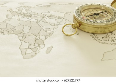 Image of map and old compass. selective focus. travel destination concept