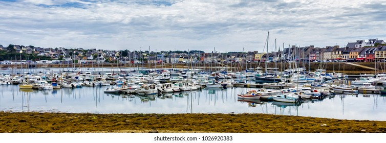 Image of marina and colored boats in Camaret sur Mer harbor in Brittany, France. Digitally filtered photo painting with details flattened and simplified