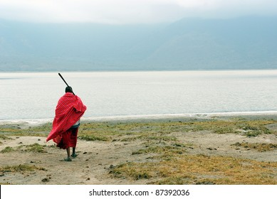Image of a Masai in front of Empakai lake