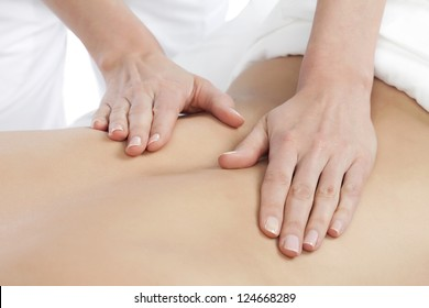 Image of a Masseuse giving a relaxing back massage at a spa