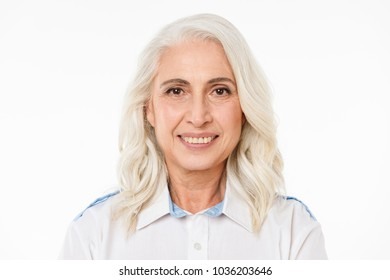 Image of mature old cheerful woman standing isolated over white background looking camera.