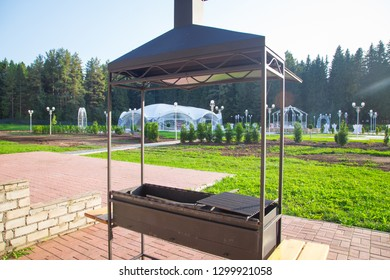 Image of the metal grill in the sunny summer day