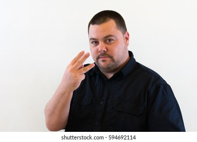Image of Middle Aged Man holding three fingers up
