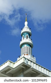 Image of Minaret of the mosque in Thailand with blue sky and cloud.