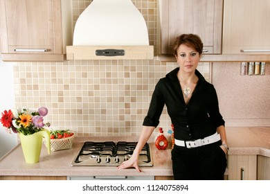 an image of  modern kitchen and woman