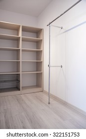 Image of modern spacious dressing room with wooden floor panels