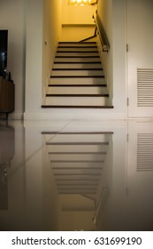 Image of modern stair with reflection on the floor.