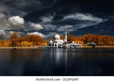 Image Of Mosque Tengku Tengah Zaharah Kuala Ibai Terengganu By The Lakeside Viewed In Infrared. custom white balance applied due to infrared image