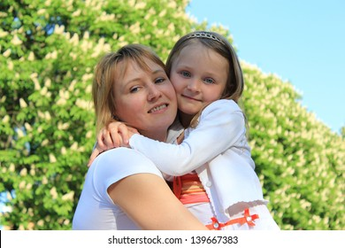 image of mother and daughter are hugging one another