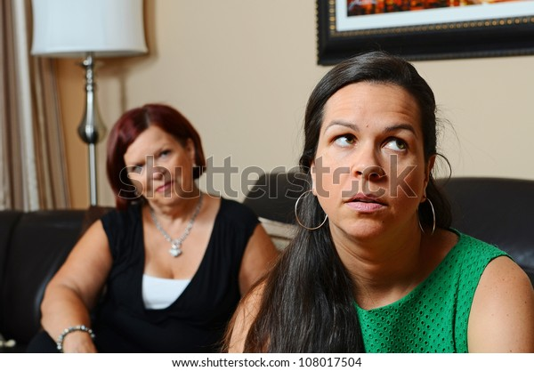 Image of a mother looking concerned for her daughter