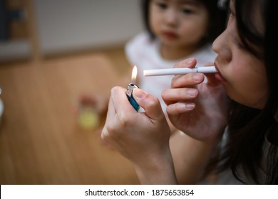 Image of a mother smoking near her child