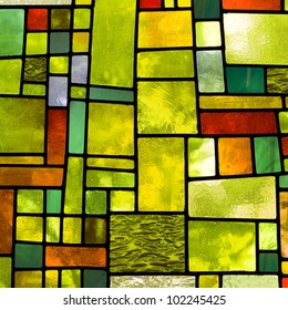 Image of a multicolored stained glass window with irregular block pattern in a hue of green, square format