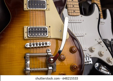 Image of multiple electric guitars