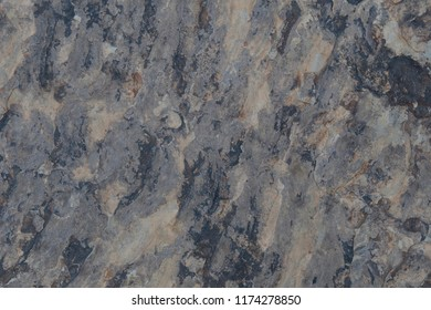 Image of multiple neutral colored stone with surface texture.