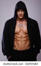 Image of muscle man posing in studio