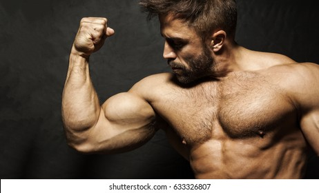 An image of a muscular man flexing his biceps