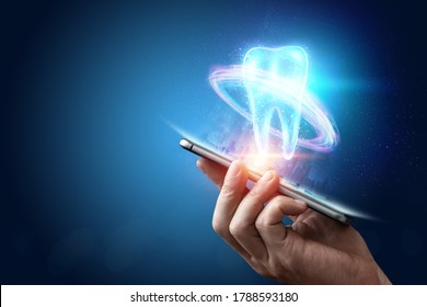 Image of a neon hologram tooth. Medicine concept, new technologies, oral care, dental prosthetics, copy space