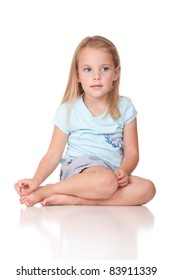 An image of a nervous girl sitting down.  Image is isolated on white.