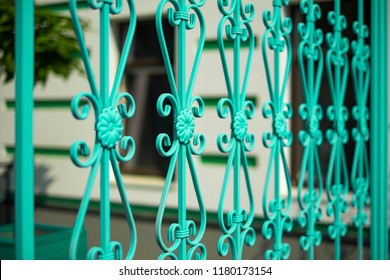 Image of a new decorative metal wrought fence with artistic forging. Iron guardrail close up.