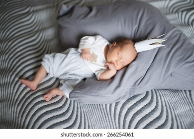 an image of newborn with crown on grey sheet