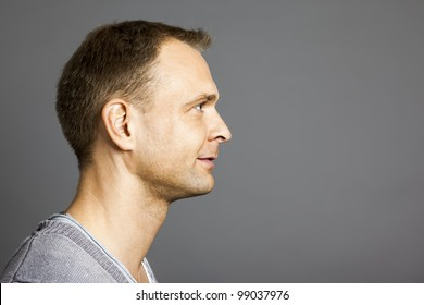 An image of a nice male portrait side view