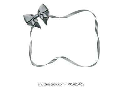 An image of a nice silver bow with ribbon by frame