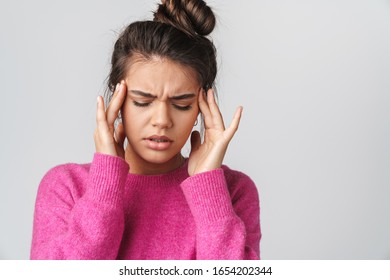 Image of nice unhappy woman with headache rubbing her temples isolated over white background
