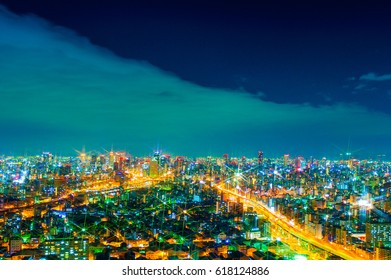 The image of the night city from the height of a bird's flight.A view of the night Osaka.Meny houses in ilumination.Dark time of the day