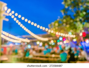 image of  night  festival on street blurred background with bokeh.