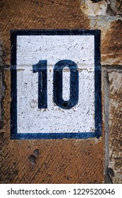 Image of the number 10 on a wall indicating a house number