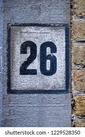 Image of the number 26 on a wall indicating a house number