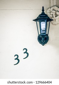 An image of the number 33 on the wall