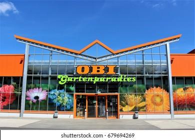 An image of a OBI store - logo - Minden/Germany - 07/18/2017 (Gartenparadies = garden paradise)