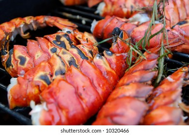 Image of obsters on a grill close up with rosemary