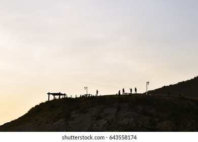 an image og a group of people at sunrise