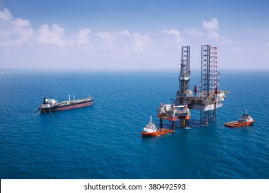Image of oil platform while cloudless day,color tone