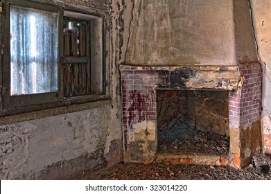 image of an old abandoned room with fireplace and window
