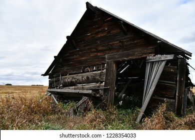 An image of old abandoned and run down wooden granaries.