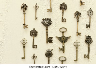 Image of old antique keys over wooden background. Top view, flat lay